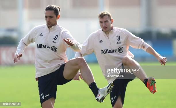 Adrien Rabiot and Dejan Kulusevski of Juventus FC train during a Juventus FC training session at JTC on February 24, 2021 in Turin, Italy.