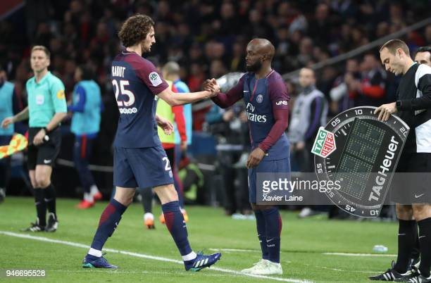 Adrien Rabiot and Lassana Diarra of Paris SaintGermain on the sideline during the Ligue 1 match between Paris Saint Germain and AS Monaco at Parc des...
