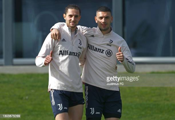 Adrien Rabiot and Merih Demiral of Juventus FC gestures during Juventus FC training session at JTC on February 24, 2021 in Turin, Italy.