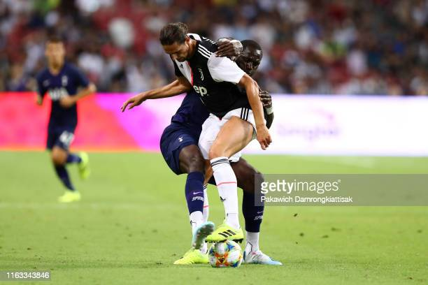 Adrien Rabiot and Moussa Sissoko of Tottenham Hotspur compete for the ball during the International Champions Cup match between Juventus and...