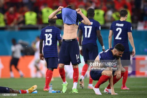 Adrien Rabiot and Olivier Giroud of France look dejected after team mate Kylian Mbappe misses their side's decisive penalty during the UEFA Euro 2020...