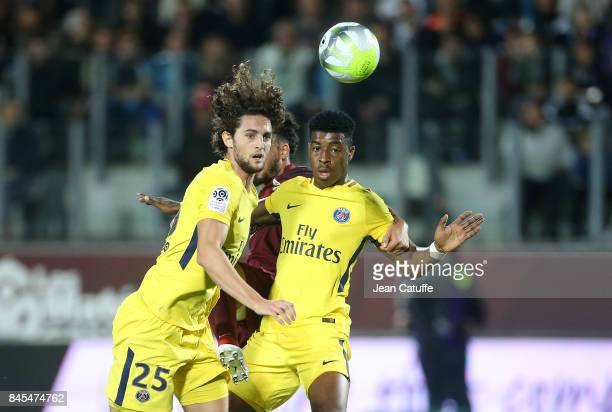Adrien Rabiot and Presnel Kimpembe of PSG during the French Ligue 1 match between FC Metz and Paris Saint Germain at Stade SaintSymphorien on...