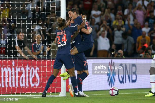 Adrien Rabiot celebrates his goal with Angel Di Maria and Christopher Nkunku during the french Ligue 1 match between Paris SaintGermain and Stade...