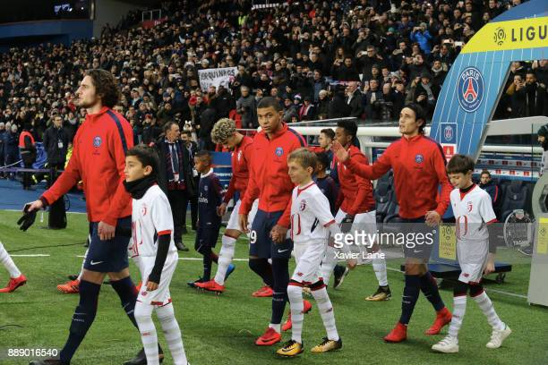 Adrien Rabiot Kylian Mbappe and Edinson Cavani of Paris SaintGermain entry in the pitch before the Ligue 1 match between Paris Saint Germain and...