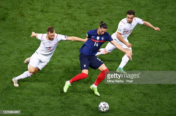 Adrien Rabiot of France is closed down by Silvan Widmer and Xherdan Shaqiri of Switzerland during the UEFA Euro 2020 Championship Round of 16 match...