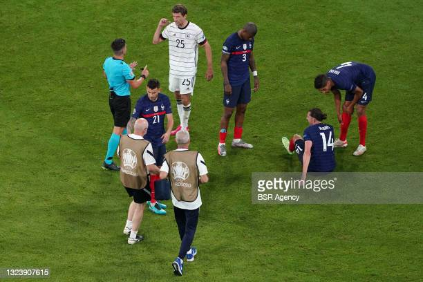 Adrien Rabiot of France receiving medial treatment during the UEFA Euro 2020 match between France and Germany at Allianz Arena on June 15, 2021 in...