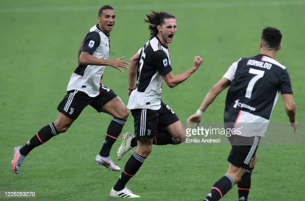 Adrien Rabiot of Juventus celebrates with his teammates Cristiano Ronaldo and Danilo Luiz da Silva after scoring the opening goal during the Serie A...
