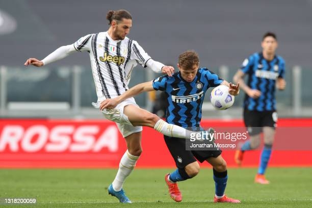 Adrien Rabiot of Juventus challenges Nicolo Barella of Internazionale during the Serie A match between Juventus and FC Internazionale at Allianz...