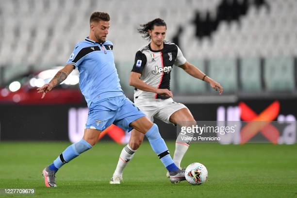 Adrien Rabiot of Juventus competers with Sergej Milinkovic-Savic of SS Lazio during the Serie A match between Juventus and SS Lazio at Allianz...
