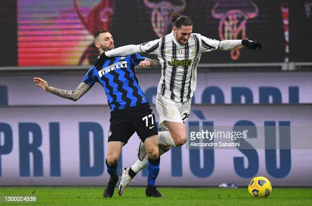 Adrien Rabiot of Juventus competes for the ball with Marcelo Brozovic of FC Internazionale during the Coppa Italia semi-final match between FC...