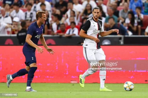 Adrien Rabiot of Juventus controls the ball under pressure of Harry Kane of Tottenham Hotspur during the International Champions Cup match between...