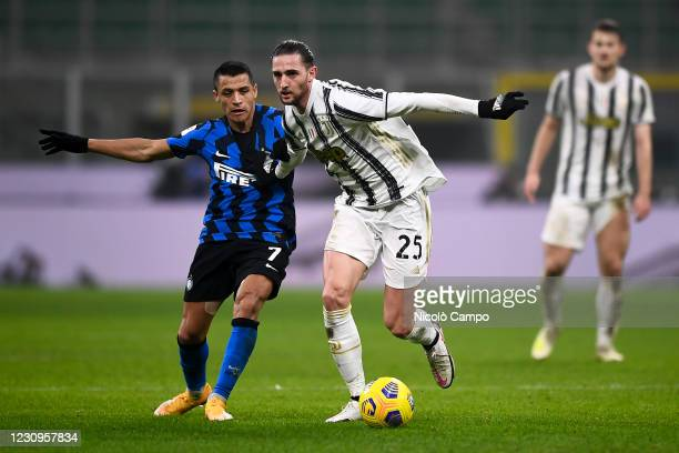 Adrien Rabiot of Juventus FC is challenged by Alexis Sanchez of FC Internazionale during the Coppa Italia football match between FC Internazionale...