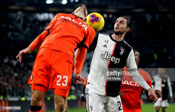 Adrien Rabiot of Juventus heads the ball against Ignacio Pussetto ofUdinese Calcio during the Serie A match between Juventus and Udinese Calcio at...