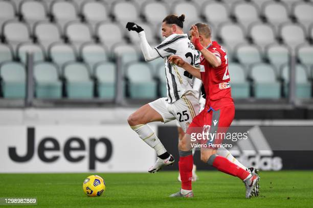 Adrien Rabiot of Juventus is tackled by Francesco Vicari of SPAL leading to a penalty during the Coppa Italia match between Juventus and SPAL at...