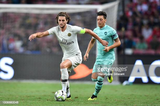 Adrien Rabiot of Paris Saint Germain and Mesut Ozil of Arsenal competes for the ball during the International Champions Cup match between Arsenal and...