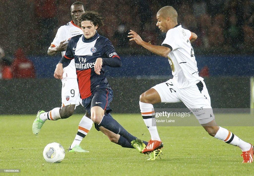 Adrien Rabiot of Paris Saint-Germain and Kevin Monnet-Paquet of Lorient FC during the French League 1 between Paris Saint-Germain FC and Lorient FC, at Parc des Princes on November 1, 2013 in Paris, France.
