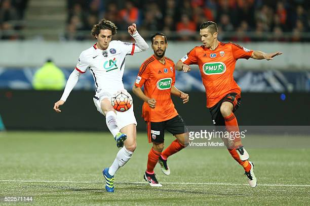 Adrien Rabiot of Paris SaintGermain and Maxime Barthelme of Lorient during the semifinal French Cup between Lorient and Paris SaintGermain at Stade...