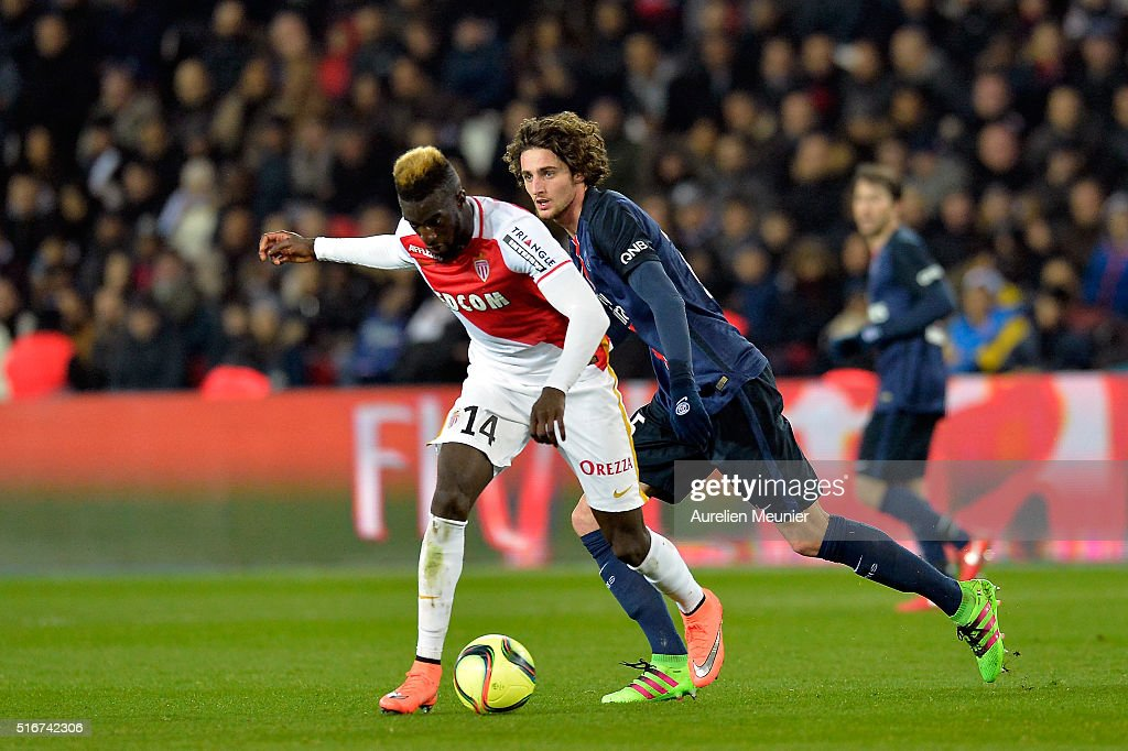 Adrien Rabiot of Paris Saint-Germain and Tiemoue Bakayako of AS Monaco fight for the ball during the French Ligue 1 match between Paris Saint-Germain and AS Monaco at Parc des Princes on March 20, 2016 in Paris, France.