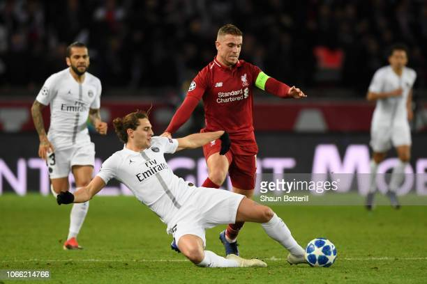 Adrien Rabiot of Paris SaintGermain battles for possession with Jordan Henderson of Liverpool during the UEFA Champions League Group C match between...