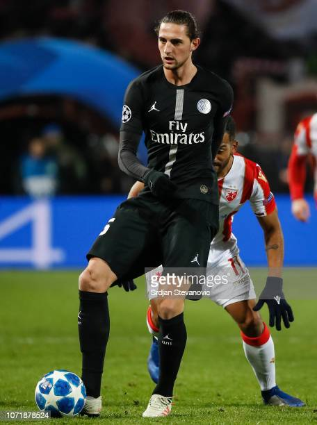 Adrien Rabiot of Paris SaintGermain in action against Lorenzo Ebecilio of Red Star Belgrade during the UEFA Champions League Group C match between...