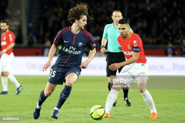 Adrien Rabiot of Paris SaintGermain in action against Radamel Falcao of AS Monaco during the Ligue 1 match between Paris Saint Germain and AS Monaco...