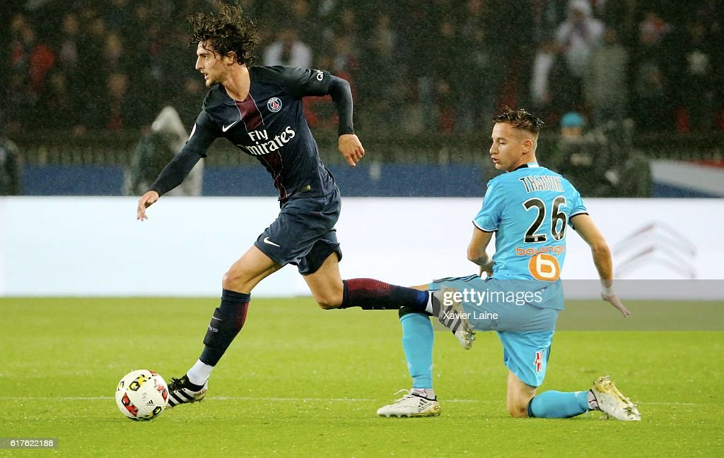 Adrien Rabiot of Paris Saint-Germain in action with Florian Thauvin of Olympique de Marseille during the French Ligue 1 match between Paris Saint-Germain and Olympique de Marseille at Parc des Princes on october 23, 2016 in Paris, France.