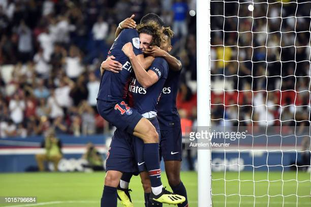 Adrien Rabiot of Paris SaintGermain is congratulated by teammate Angel Di Maria after scoring during the Ligue 1 match between Paris SaintGermain and...