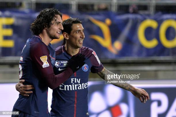 Adrien Rabiot of Paris SaintGermain is congratulated by teammate Angel Di Maria after scoring during the League cup match between Amiens and Paris...
