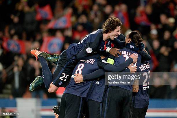 Adrien Rabiot of Paris SaintGermain jumps on his teammates to celebrate the goal of Gregory Van Der Wiel during the Ligue 1 game between Paris...