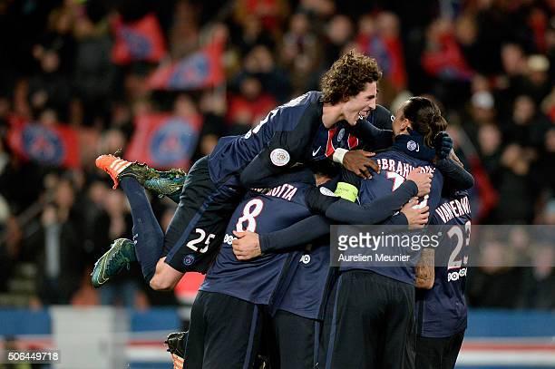 Adrien Rabiot of Paris Saint-Germain jumps on his teammates to celebrate the goal of Gregory Van Der Wiel during the Ligue 1 game between Paris...