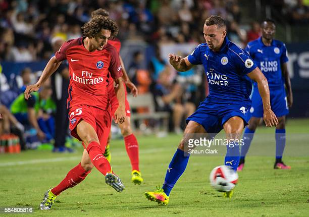 Adrien Rabiot of Paris SaintGermain passes the ball as Daniel Drinkwater of Leicester City defends during the International Champions Cup 2016 match...
