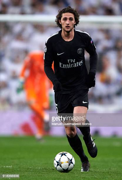 Adrien Rabiot of Paris SaintGermain runs with the ball during the UEFA Champions League Round of 16 First Leg match between Real Madrid and Paris...