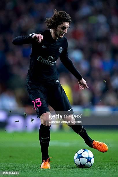 Adrien Rabiot of Paris SaintGermain strikes the ball during the UEFA Champions League Group A match between Real Madrid CF and Paris SaintGermain at...