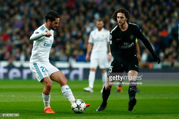 Adrien Rabiot of PSG and Isco of Real Madrid during the UEFA Champions League Round of 16 First Leg match between Real Madrid and Paris SaintGermain...