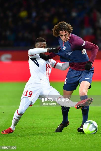 Adrien Rabiot of PSG and Nicolas Pepe of Lille during the Ligue 1 match between Paris Saint Germain and Lille OSC at Parc des Princes on December 9...