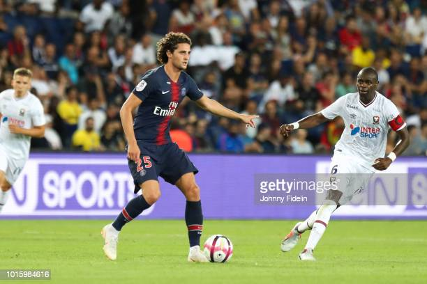 Adrien Rabiot of PSG and Prince Oniangue of Caen during the French Ligue 1 match between Paris Saint Germain and Caen at Parc des Princes on August...