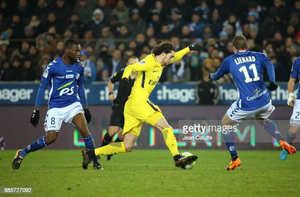 Adrien Rabiot of PSG between JeanEudes Aholou and Dimitri Lienard of Strasbourg during the French Ligue 1 match between RC Strasbourg Alsace and...