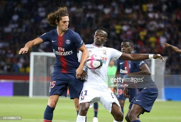 Adrien Rabiot of PSG Casimir Ninga of SM Caen during the french Ligue 1 match between Paris SaintGermain and Stade Malherbe Caen at Parc des Princes...