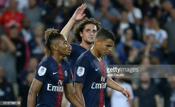 Adrien Rabiot of PSG celebrates his goal between Christopher Nkunku and Thiago Silva during the french Ligue 1 match between Paris SaintGermain and...