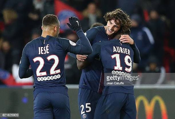 Adrien Rabiot of PSG celebrates his goal with Jese Rodriguez and Serge Aurier during the French Ligue 1 match between Paris SaintGermain and Stade...