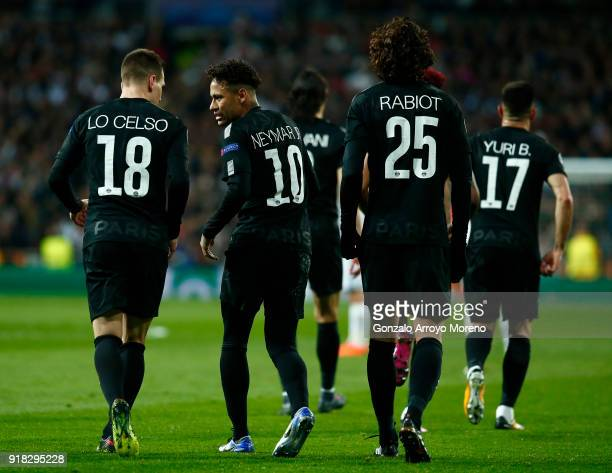 Adrien Rabiot of PSG celebrates scoring the first goal with Neymar of PSG during the UEFA Champions League Round of 16 First Leg match between Real...