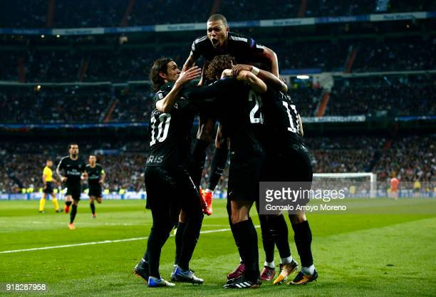 Adrien Rabiot of PSG celebrates scoring the first goal with team mates during the UEFA Champions League Round of 16 First Leg match between Real...