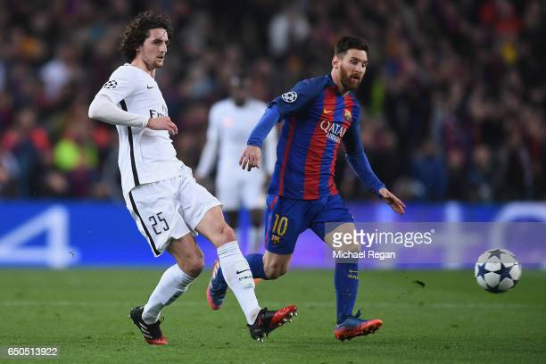 Adrien Rabiot of PSG in action with Lionel Messi during the UEFA Champions League Round of 16 second leg match between FC Barcelona and Paris...