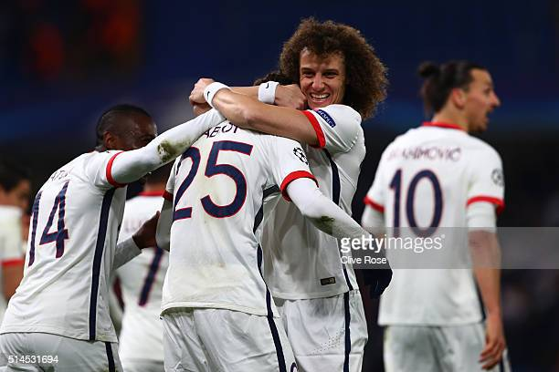 Adrien Rabiot of PSG is congratulated by teammate David Luiz of PSG after scoring the opening goal during the UEFA Champions League round of 16,...