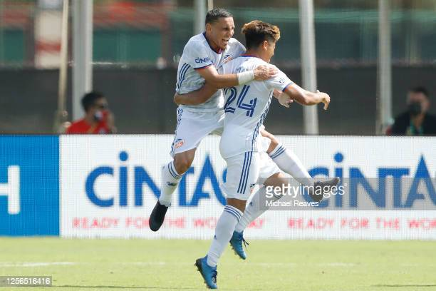 Adrien Regattin of FC Cincinnati celebrates with Frankie Amaya after he scored a goal in the 76th minute against Atlanta United during a Group E...