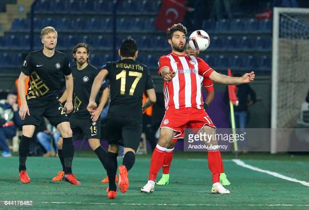 Adrien Regattin of Osmanlispor is in action against Karim Ansarifard of Olympiacos during the UEFA Europa League final 32 soccer match between...