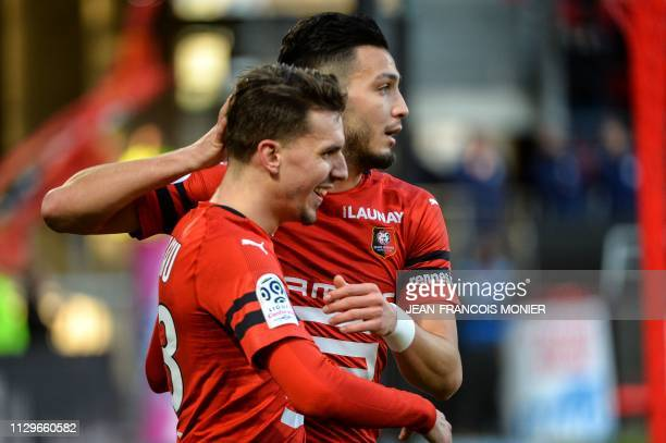 Adrien Rennes' French midfielder Adrien Hunou is congratulated by Rennes' Algerian defender Ramy Bensebaini after scoring his team's second goal...