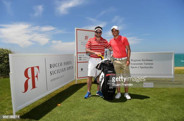 Adrien Saddier of France and caddie pose for a picture during practice prior to the start of The Rocco Forte Open at the Verdura golf resort on May 8...
