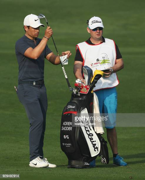 Adrien Saddier of France looks on with his caddie during day two of the Hero Indian Open at Dlf Golf and Country Club on March 9 2018 in New Delhi...