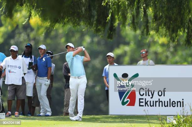 Adrien Saddier of France tees off on the 18th hole watched by Chase Koepka of the United States during day two of the BMW South African Open...